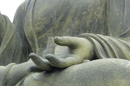 hand rock monument statue buddhism religion